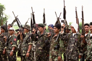 "Moro Islamic Liberation Front members pose during one of their ""meetings"" in Cotabato in this 2007 Yahoo.com photo grab."