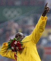 Jamaican sprinter Usain Bolt poses as he is awarded with a gold medal in the recently concluded Beijing Olympics.
