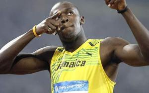Usain Bolt seen here again posing after winning the 100m Men's sprint