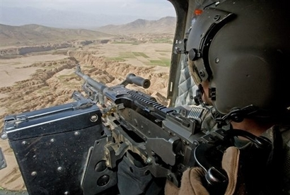 An American attack chopper goes on patrol near the Afghan-Paki border in this undated Yahoo.com photo.