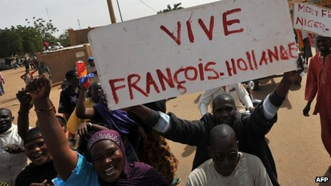 Citizens of Gao carry banners praising French President Francois Hollande.Photo courtesy of the AFP and taken from www.bbc.co.uk