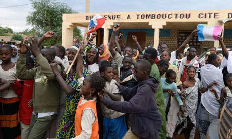 Residents of Timbuktu welcome French liberation.Photo taken from www.theguardian.co.uk