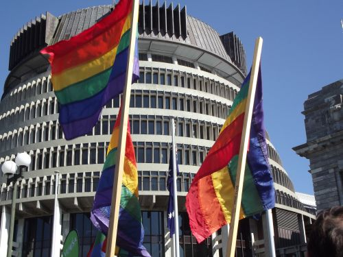 Rainbow flags fly proudly in front of New Zealand's parliament.