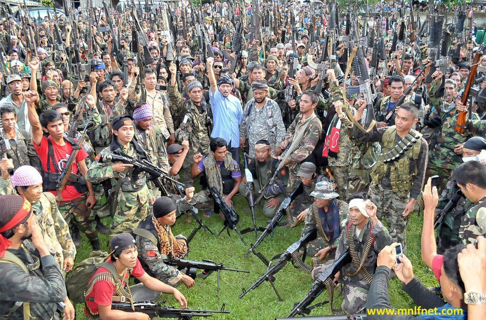Thousands of ethnic Tausug fighters, as pictured in this file photo from mnlfnet.com, evade maritime security forces of Malaysia and the Philippines each day to join the guerrilla war in Sabah.