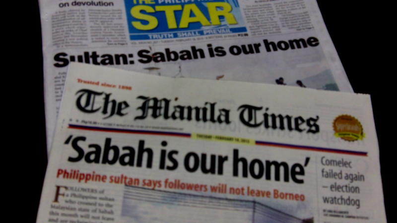 Photo shows Philippine Star and Manila Times headlines on the Sabah conflict.