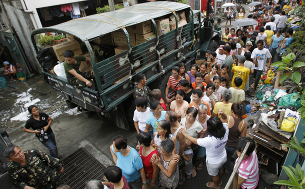 The Philippine Army distributing relief goods to flood-hit residents.