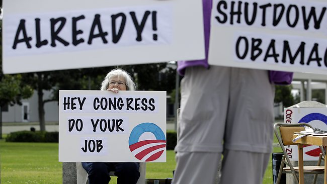 Americans protest their Congress' inability to compromise in order to finally end the shutdown and settle debts.