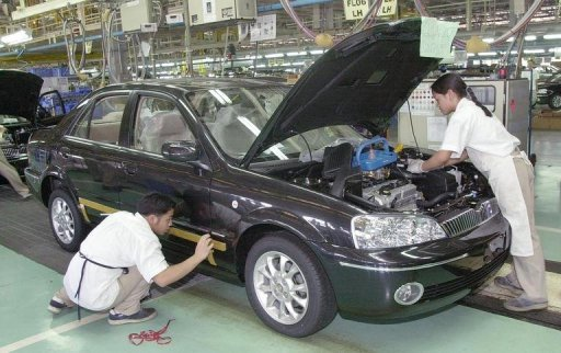 Filipino workers of the Ford Manufacturing Plant in the Philippines, prior to its closure in 2011. Photo taken from Yahoo! News.