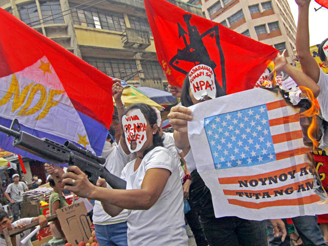Suporters of the far-left group Communist Party of the Philippines and its' armed wing the New People's Army stage a protest against the Aquino administration and the United States government in this GMANews file photo. Photo taken from www.gmanetwork.com