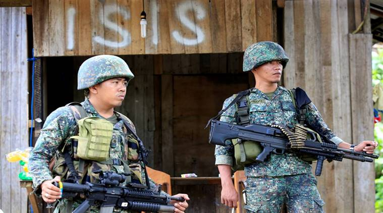 FILE PHOTO: Soldiers stand guard along the main street of Mapandi village as government troops continue their assault on insurgents from the Maute group, who have taken over large parts of Marawi City